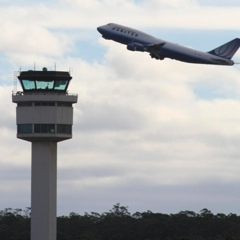 Control Tower With Airplane