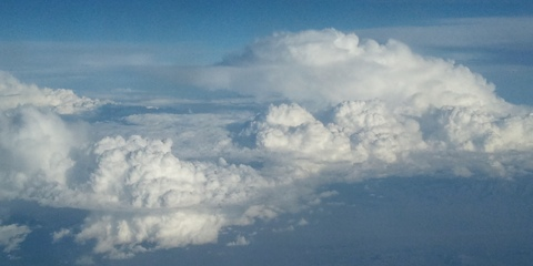Amazing fluffy clouds outside the airplane window.