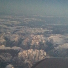 Flying over snow covered Rocky Mountains