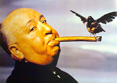 Alfred Hitchcock with a bird perched on his cigar