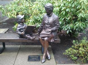 Bronze life-size sculpture of woman and boy with book
