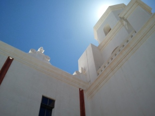 Arizona sun glows behind the pristine white stucco.