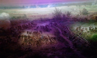 Visitors move around the circular space as the battle moved.