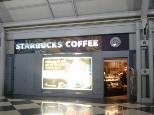 Starbucks Coffee across from ORD's gate B14.