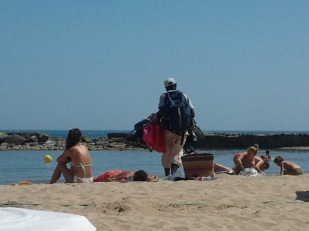 Spain's unemployment rate is 25%, and there are many street and beaches vendors.
